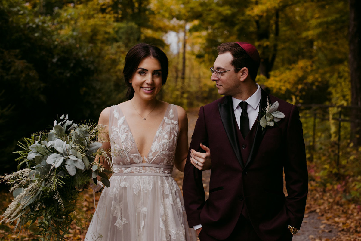 bride and groom on wooded path at outdoor jewish wedding