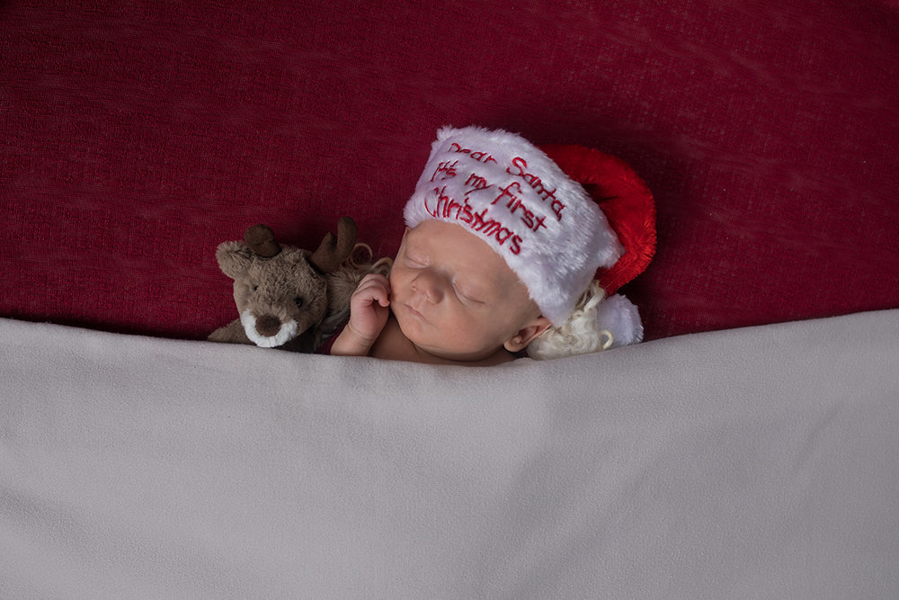 Newborn baby boy Christmas photos with reindeer