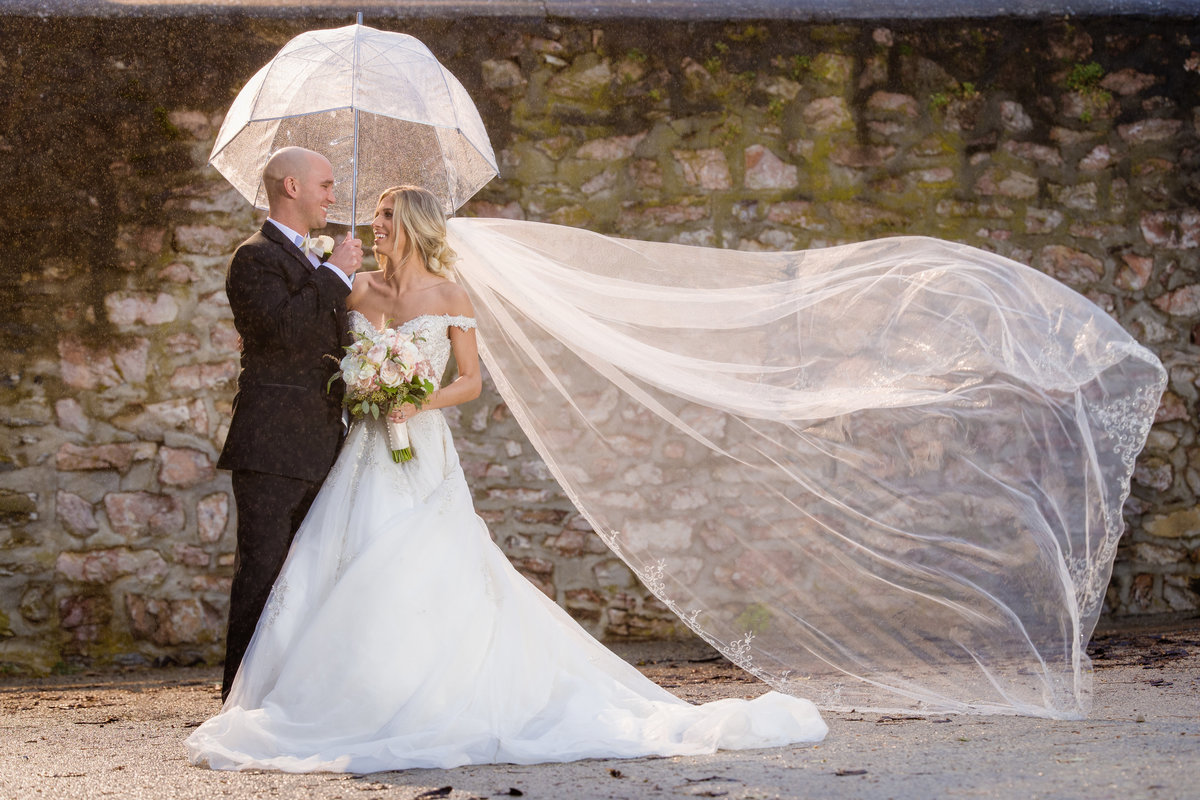 Bride and Groom in a sun shower