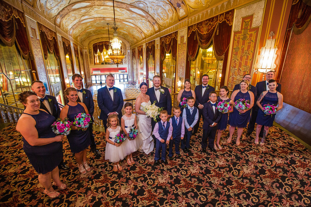 Bridal party poses at the top of the Grand Staircase at the Warner Theatre