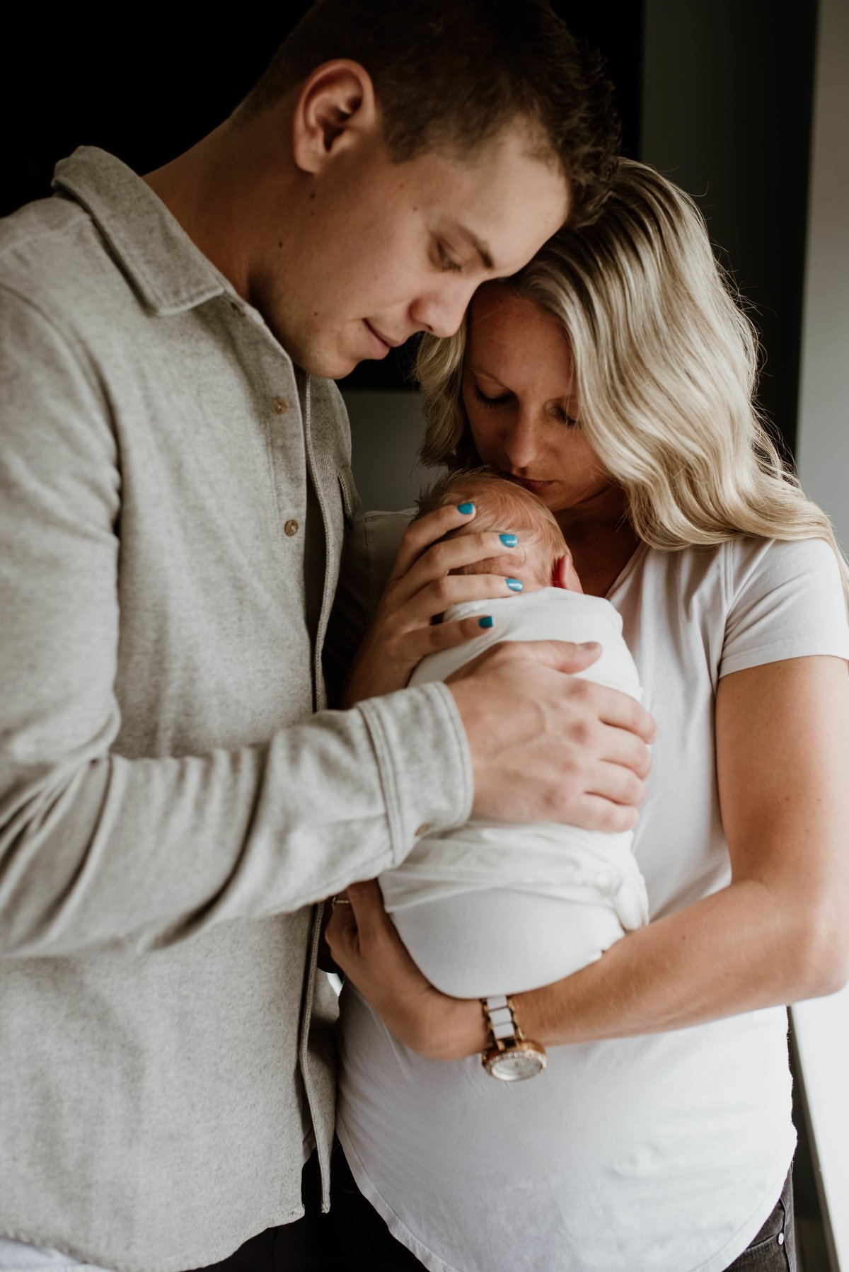 couple holding newborn baby