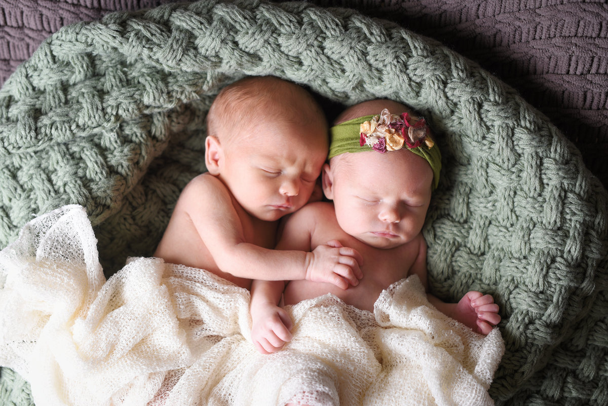 Beautiful Mississippi Newborn Photography: newborn boy and girl twins snuggling in a basket