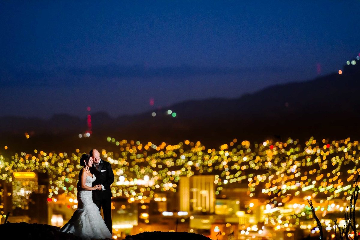 bride and groom night portrait  of el paso skyline  by stephane lemaire photography