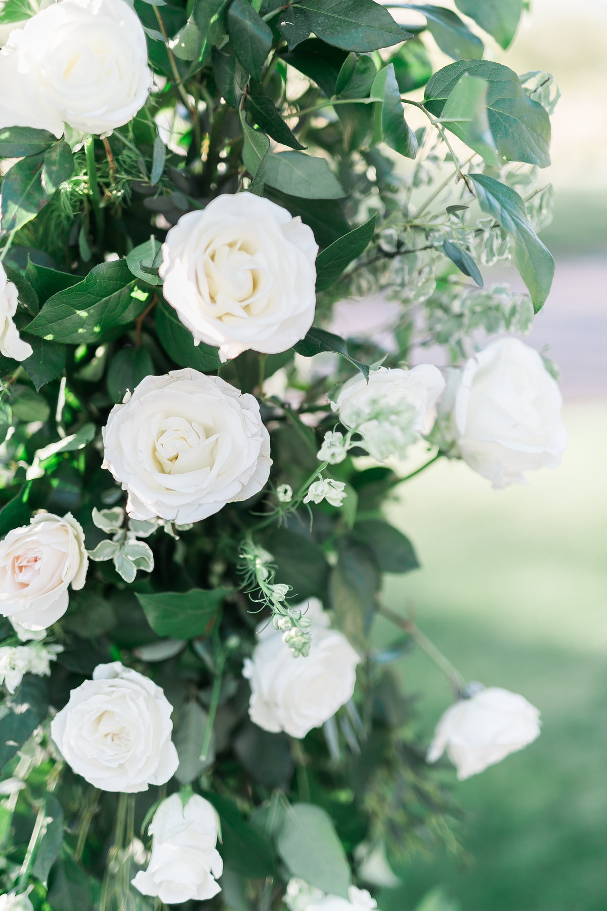 white floral blooms for ceremony arch