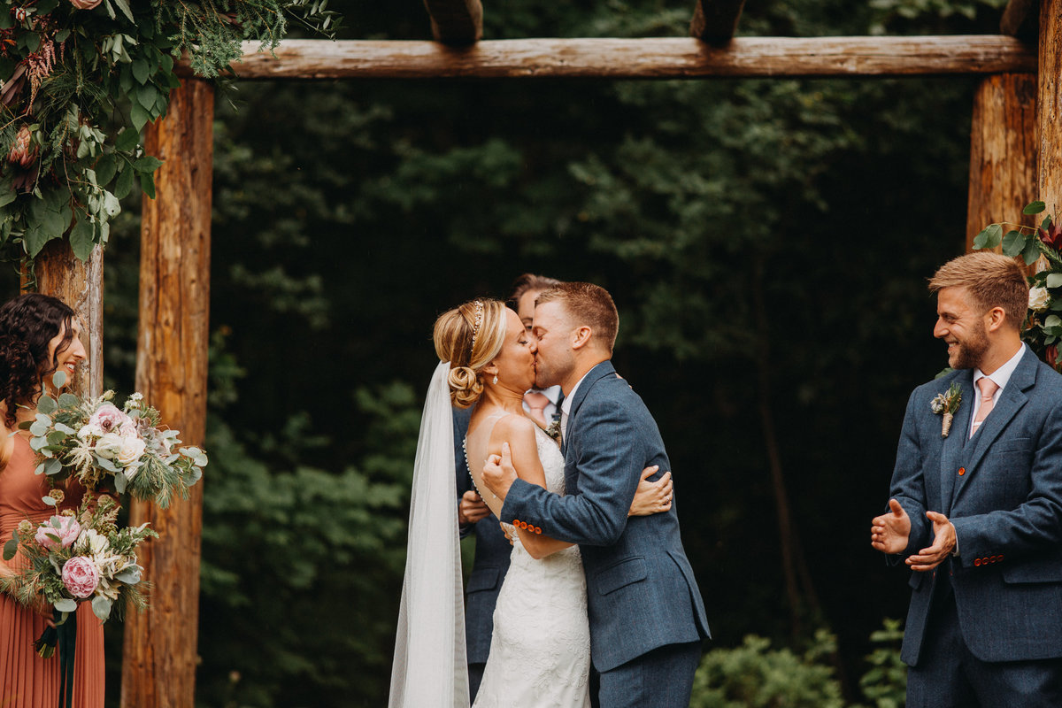 Bride and grooms first kiss