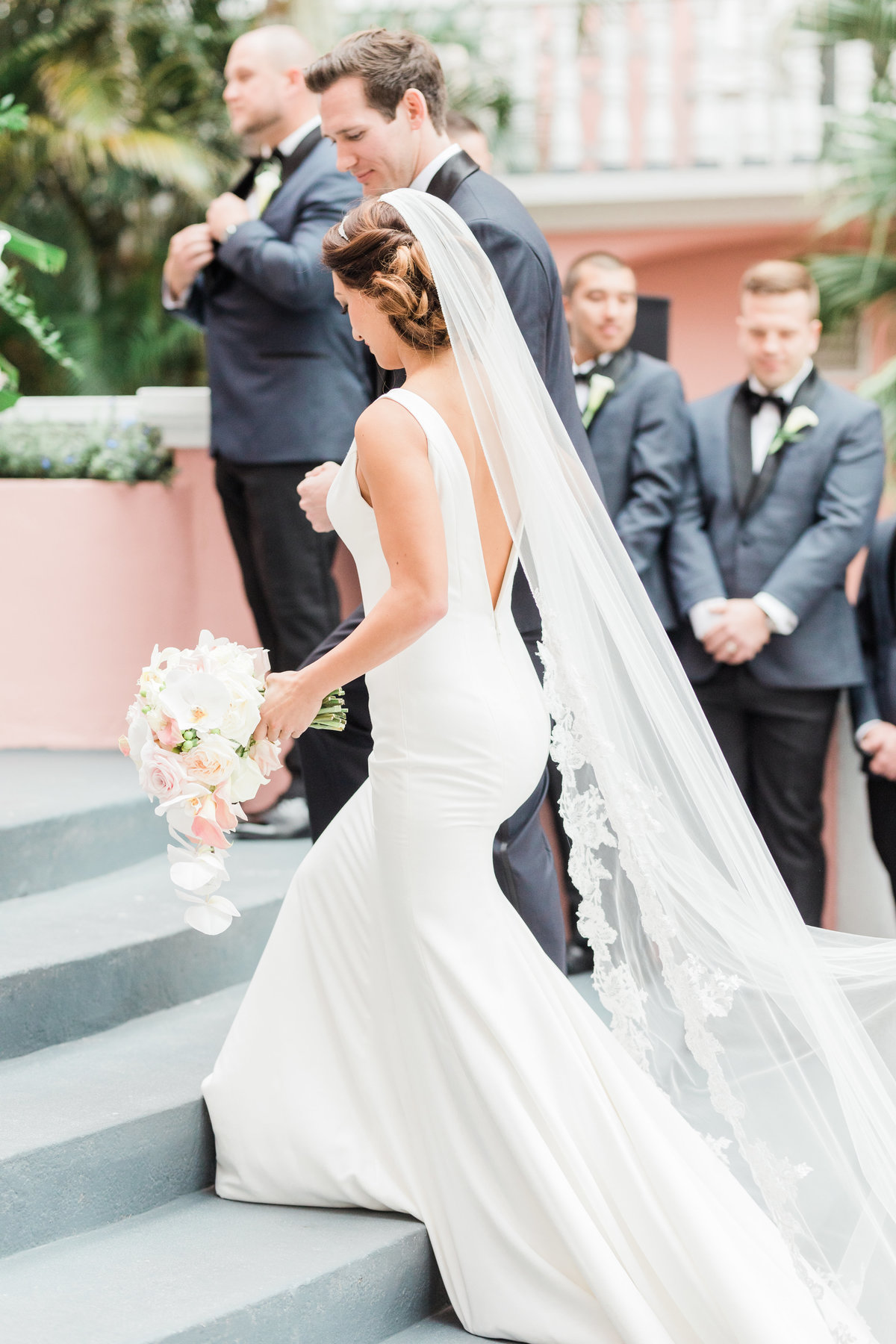 bride walking up steps during ceremony at don cesar wedding in st petersburg florida by costola photography