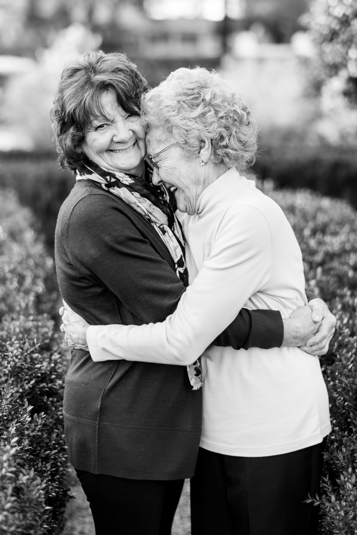 Great grandmother embracing her daughter while laughing