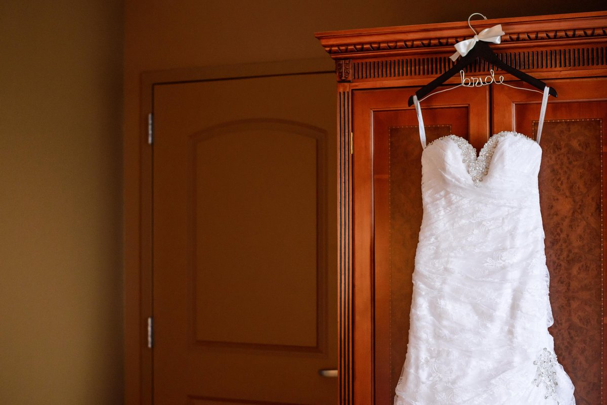 Classic White strapless wedding dress with personalized hanger getting ready on the wedding day