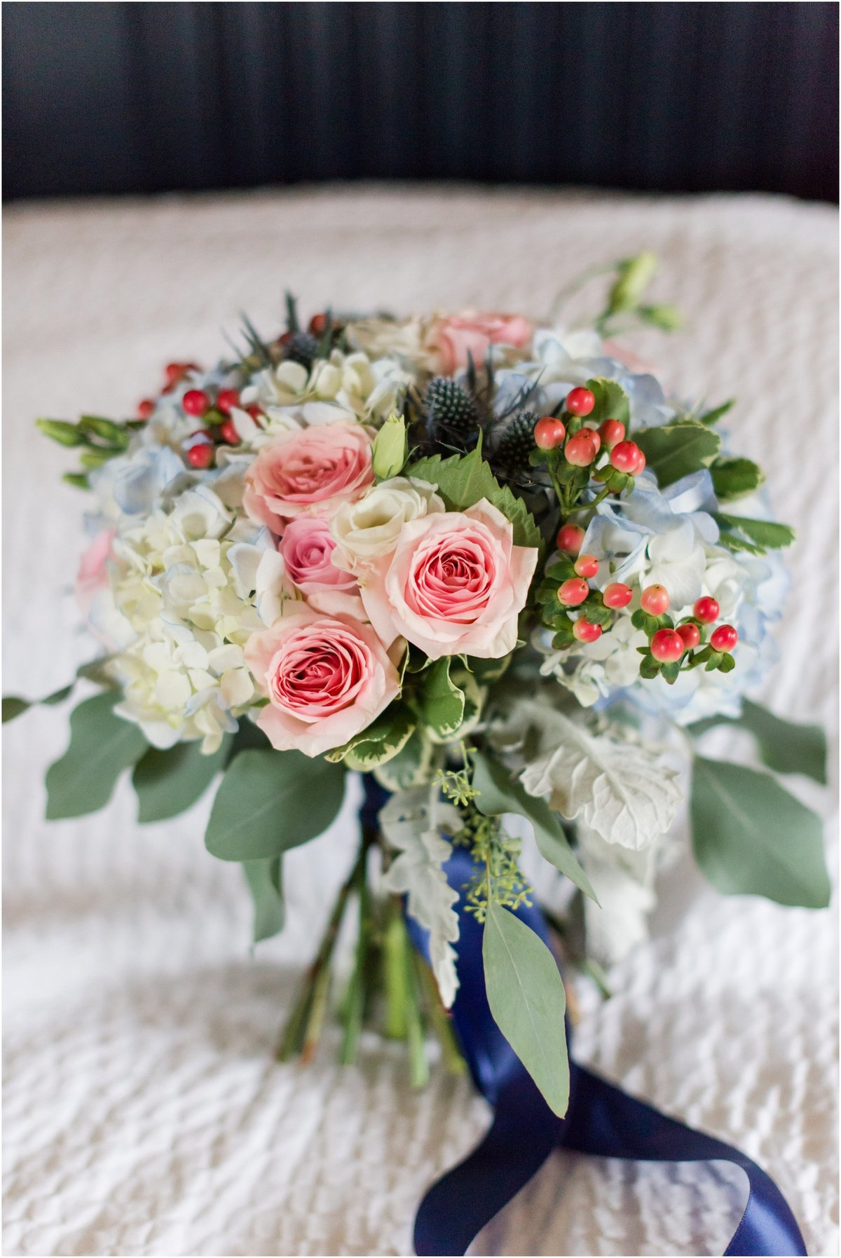 Pink roses, white and blue hydrangea, berries and thistle , navy blue ribbon
