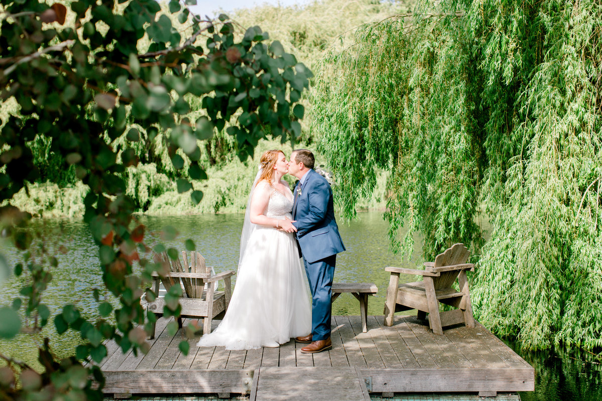 Bride and Groom enjoying first look on the dock at Olympias Valley Estate in Petaluma California