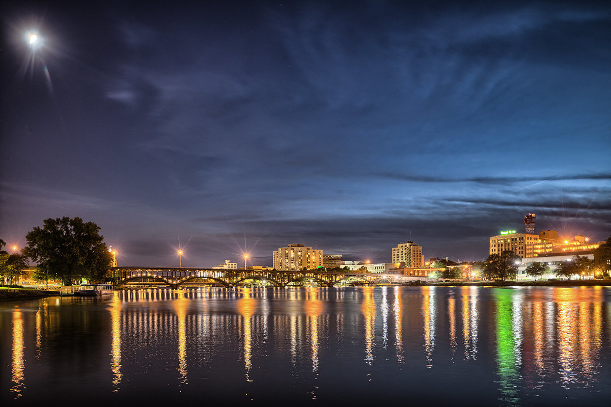 downtown rockford illinois at nighttime with reflection in the rock river