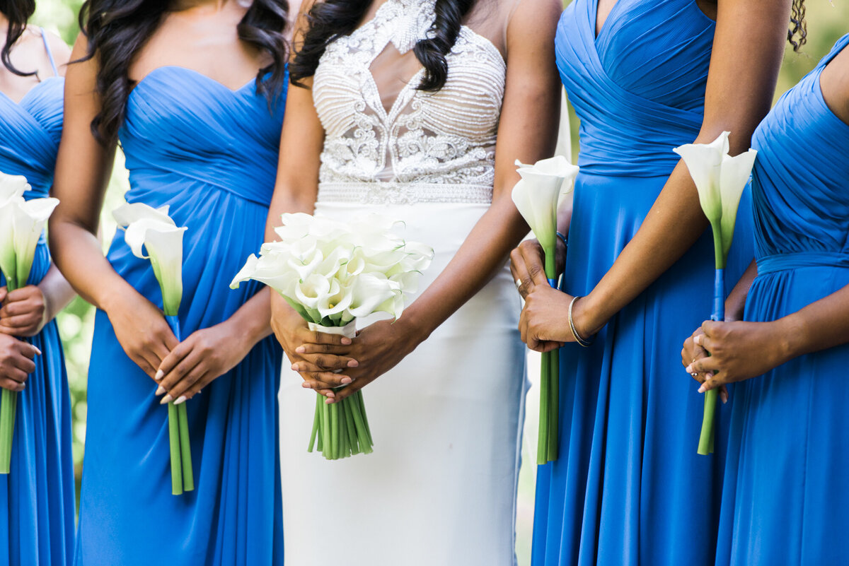 Bride standing with bridesmaids in blue dresses