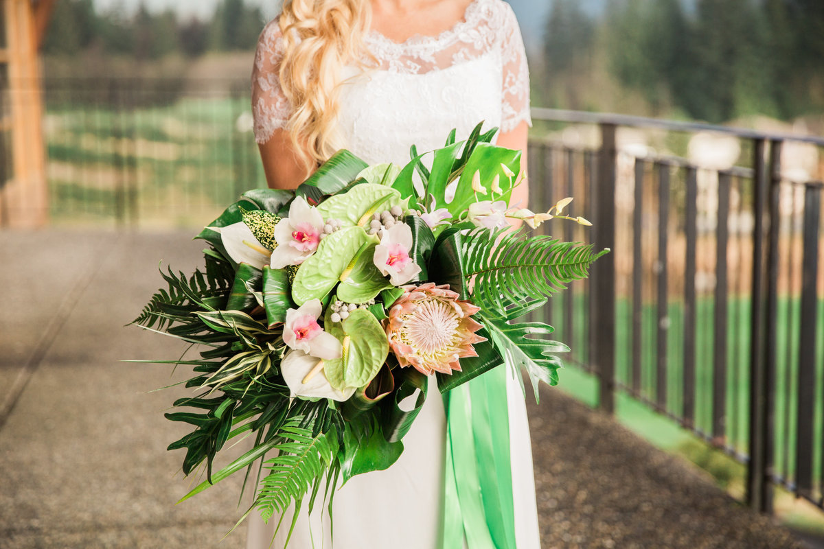 Pastel tropical bridal bouquet with orchids