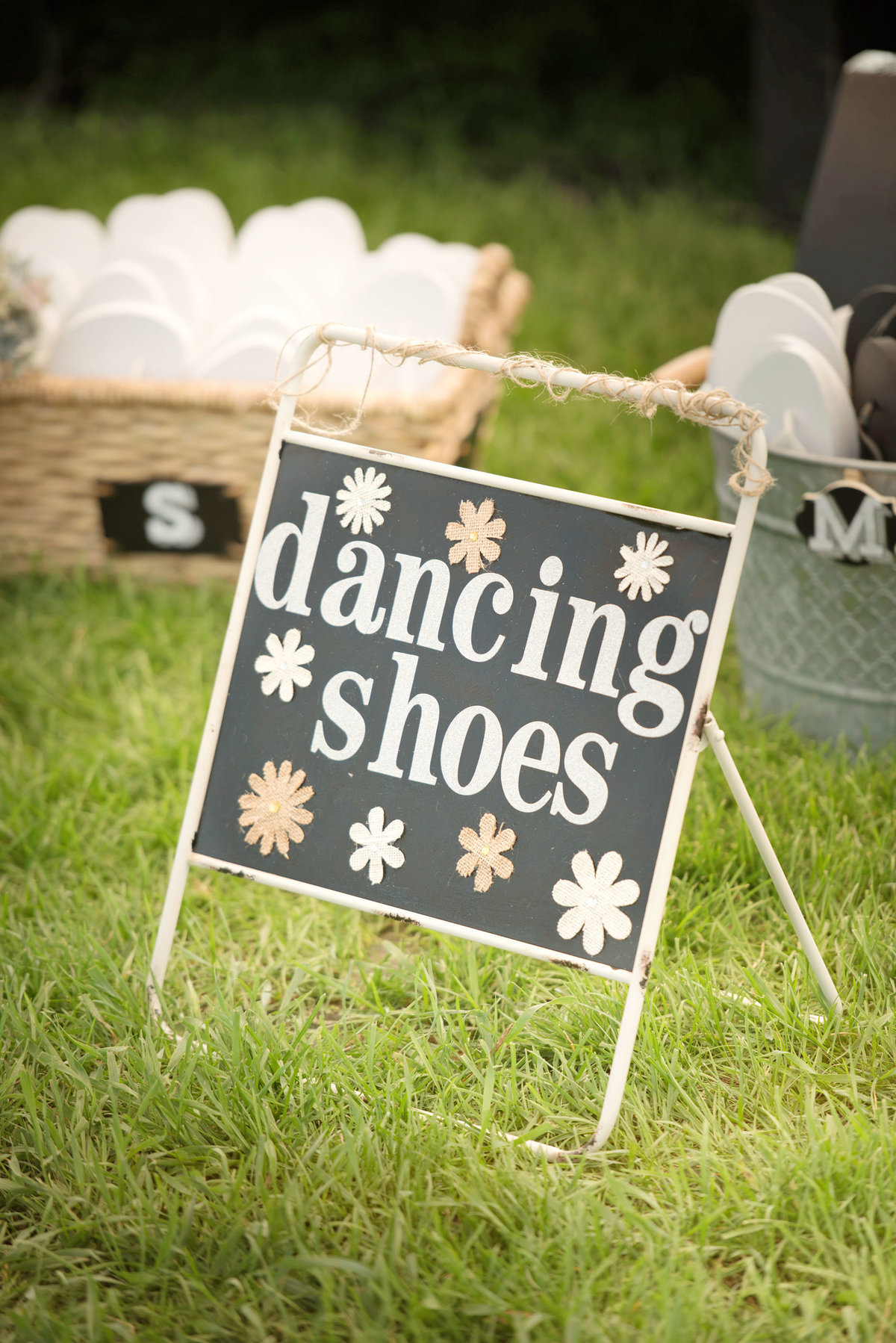 Dancing shoes sign at a tented wedding