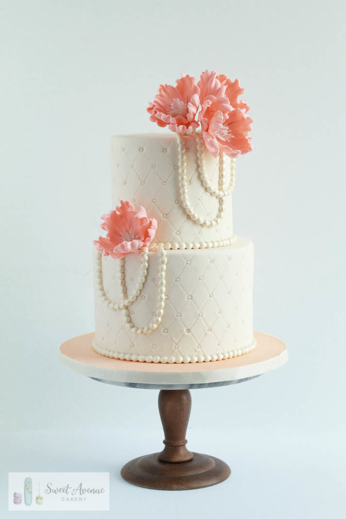 ivory and peach vintage wedding cake with pearls and sugar peonies