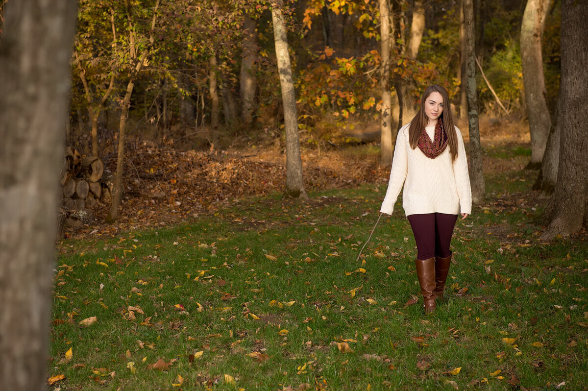 fall leaves forest park senior girl white sweater red scarf falling leaves