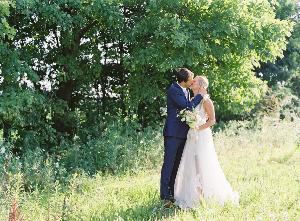 Bridal Portrait Bride and Groom in a sunlit field with wild flowers and trees all white bouquet | Pittsburgh Wedding Photographer | Anna Laero