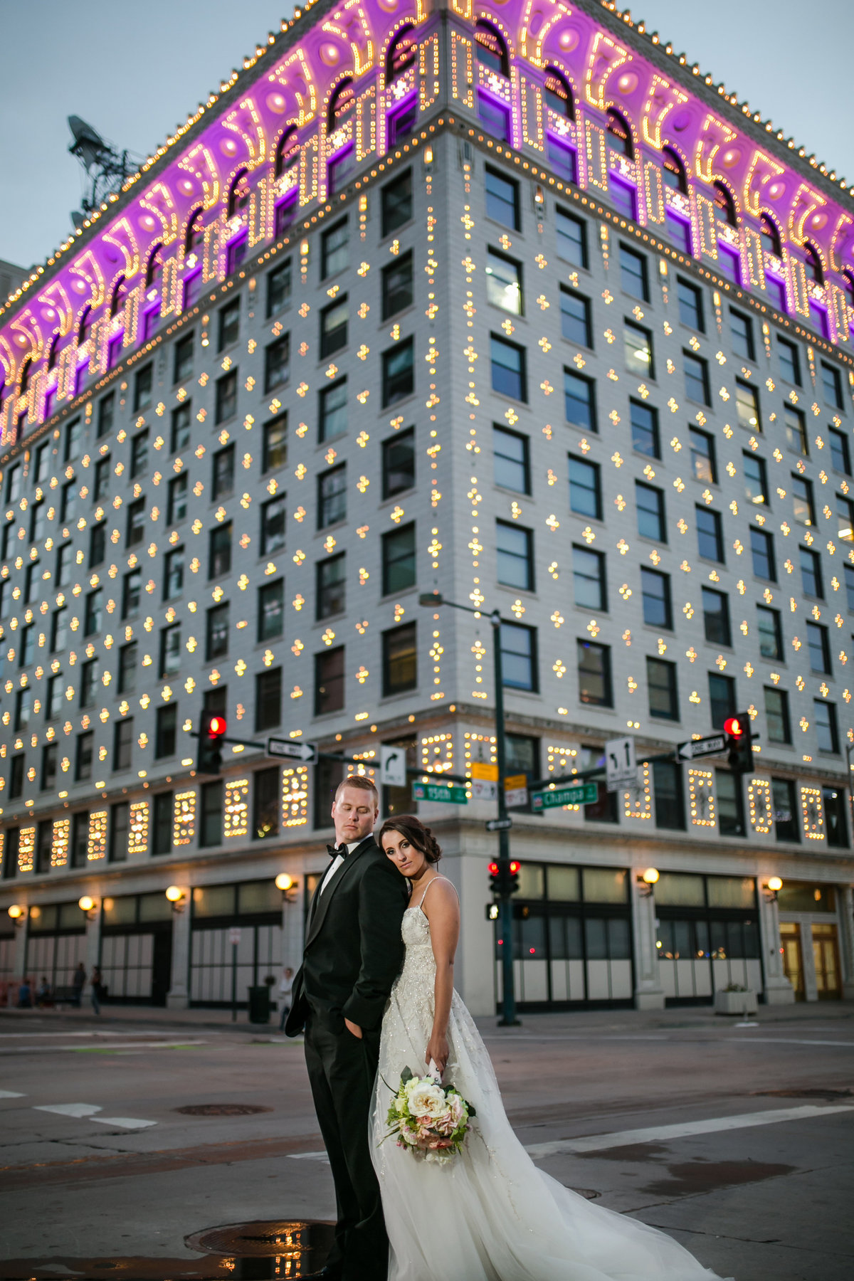 gas and electric building with bride and groom