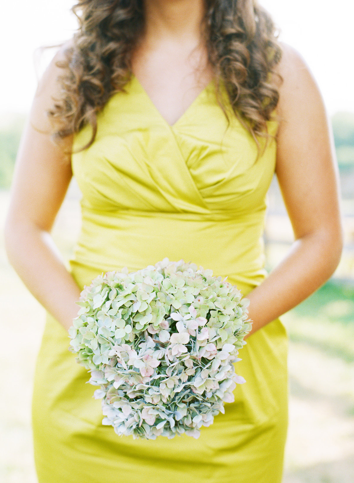 green bridesmaids dress and blue hydrangea