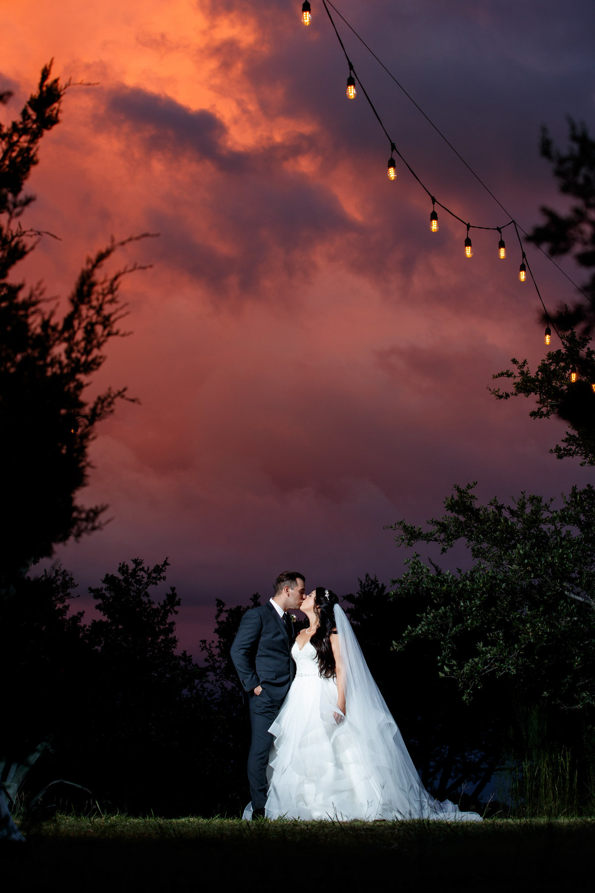 terrace club wedding photographer amazing sunset bride groom kiss 2600 US-290, Dripping Springs, TX 78620