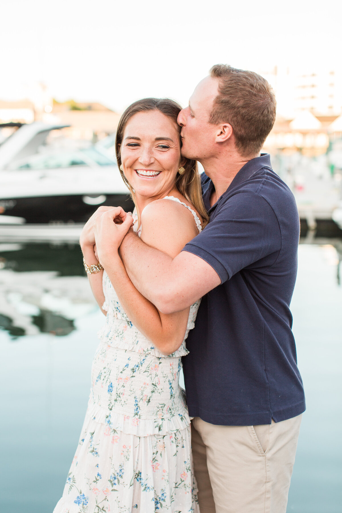 couple kissing in marina in Boston