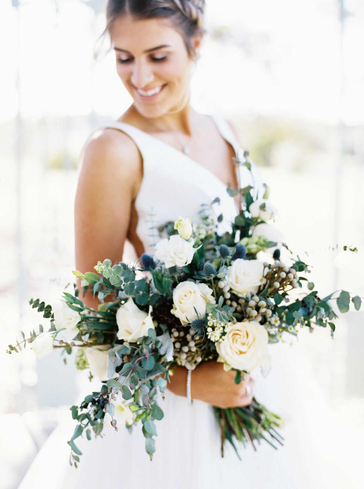 Bride holding white and cream bouquet