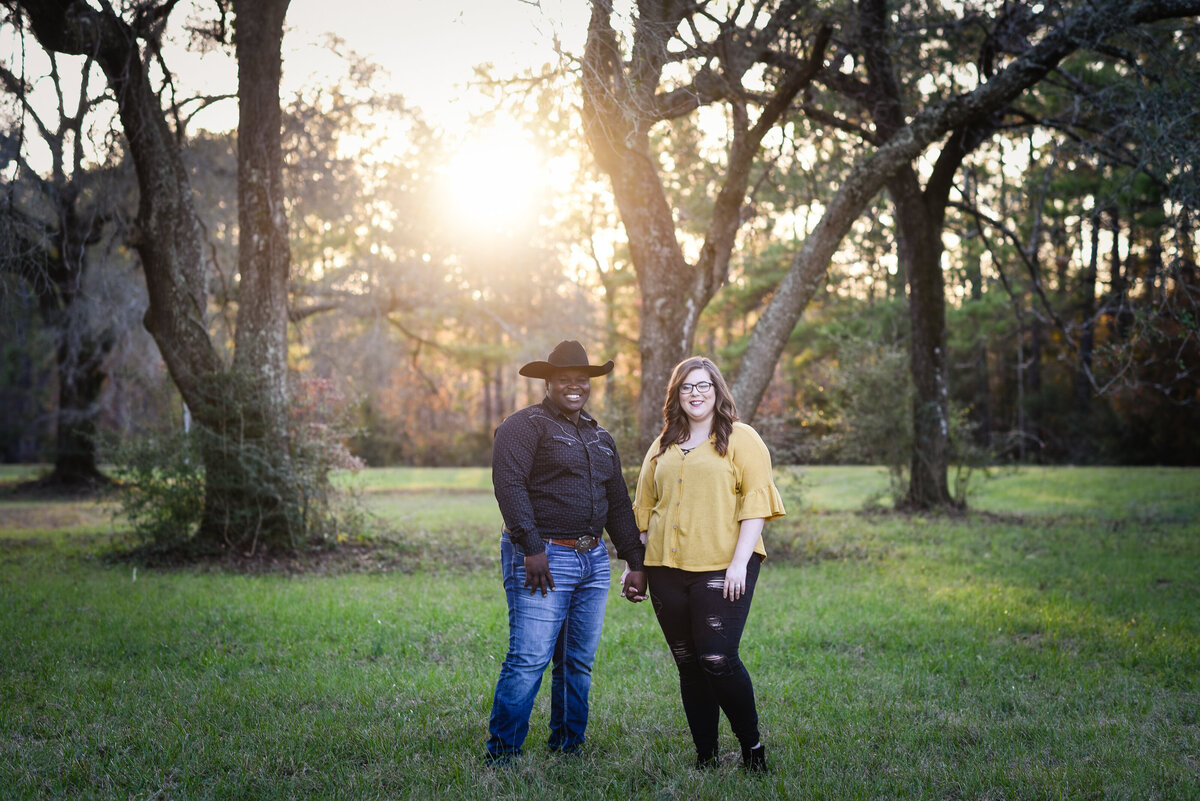 Beautiful Mississippi Engagement Photography: couple poses among oak trees at sunset