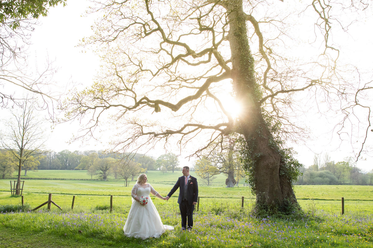 Wedding photo of couple in grounds of Rockbeare Manor Exeter Devon_