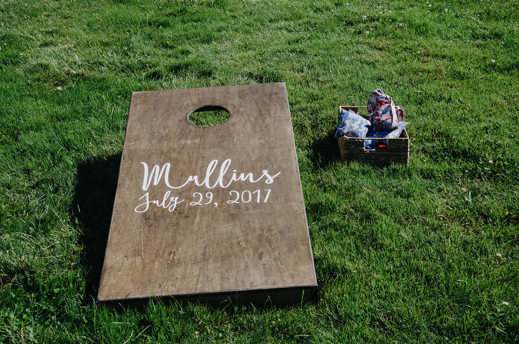 Monica_Relyea_Events_Dawn_Honsky_Photography_bride_and_groom_Nostrano_vineyard_ceremony_boho_cornhole_Meg_and_TJ