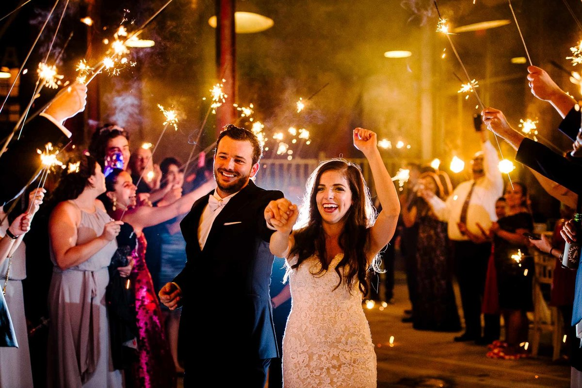 bride and groom sparklers exit at epic railyard  in el paso by stephane lemaire photography