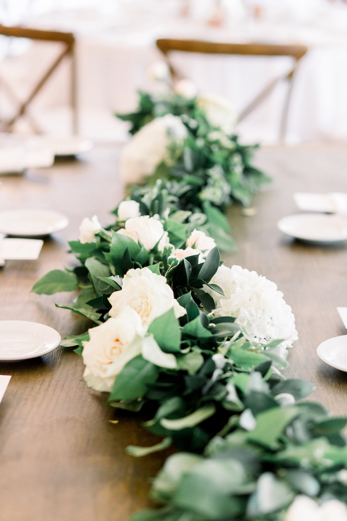 Close up of garland as a table runner at a wedding tablescape