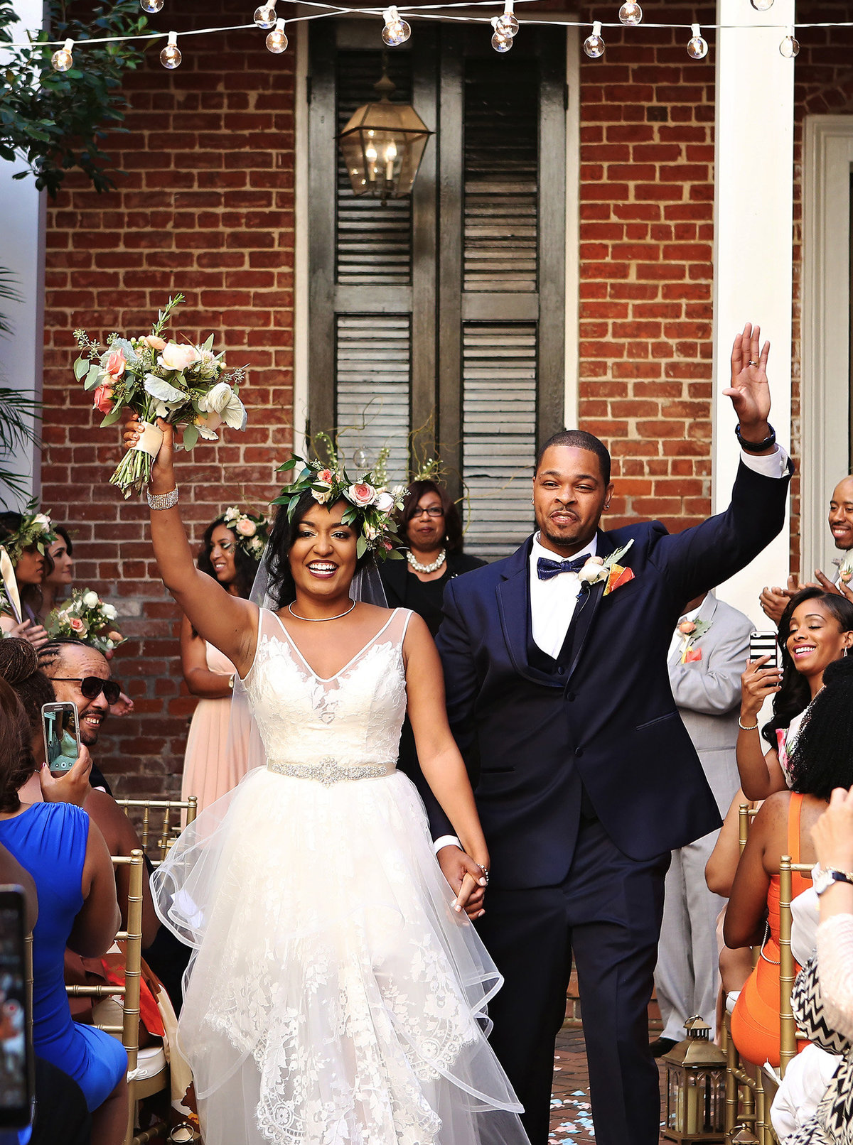 nola bride and groom walking down the aisle