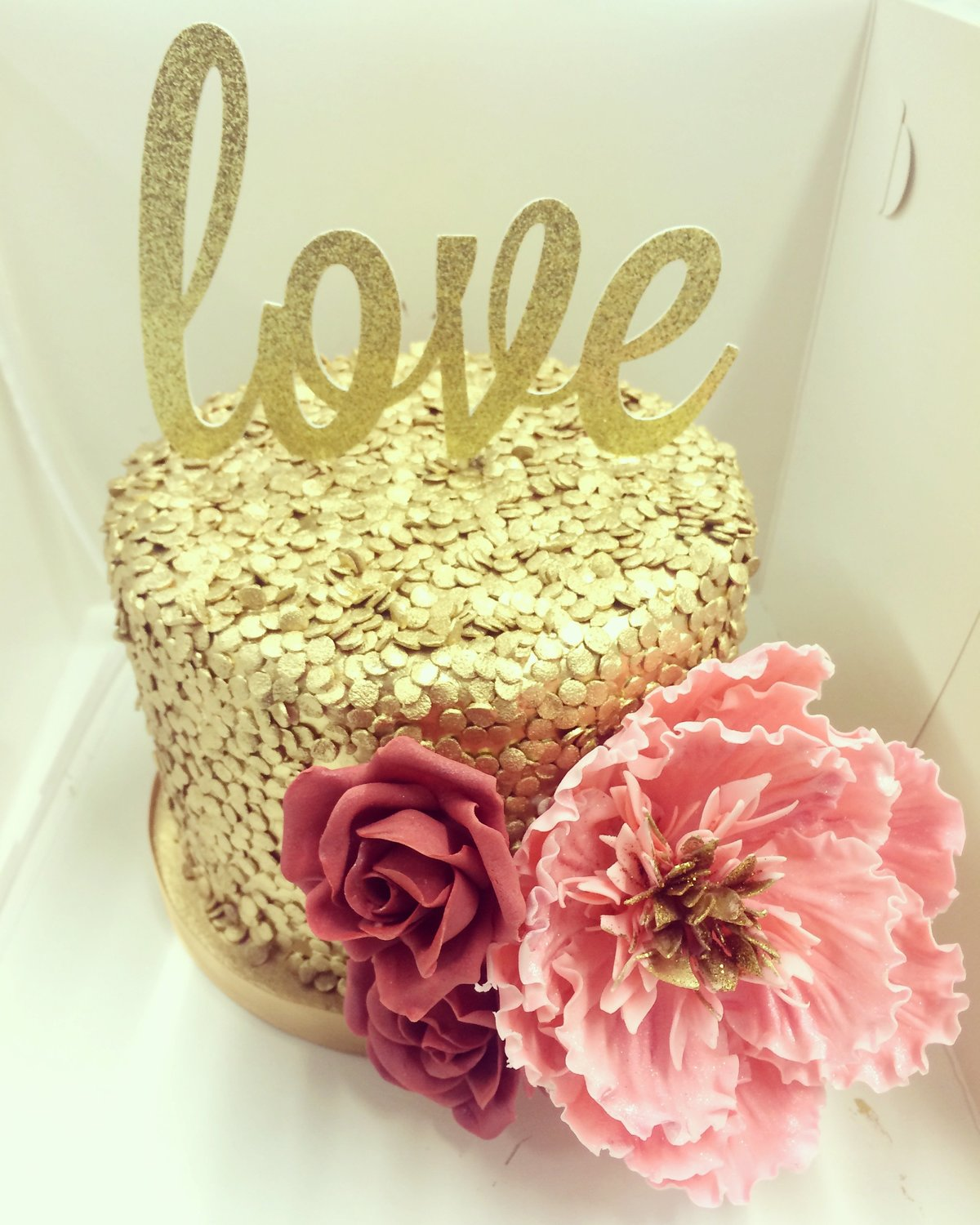 Gold Sequins cutting cake