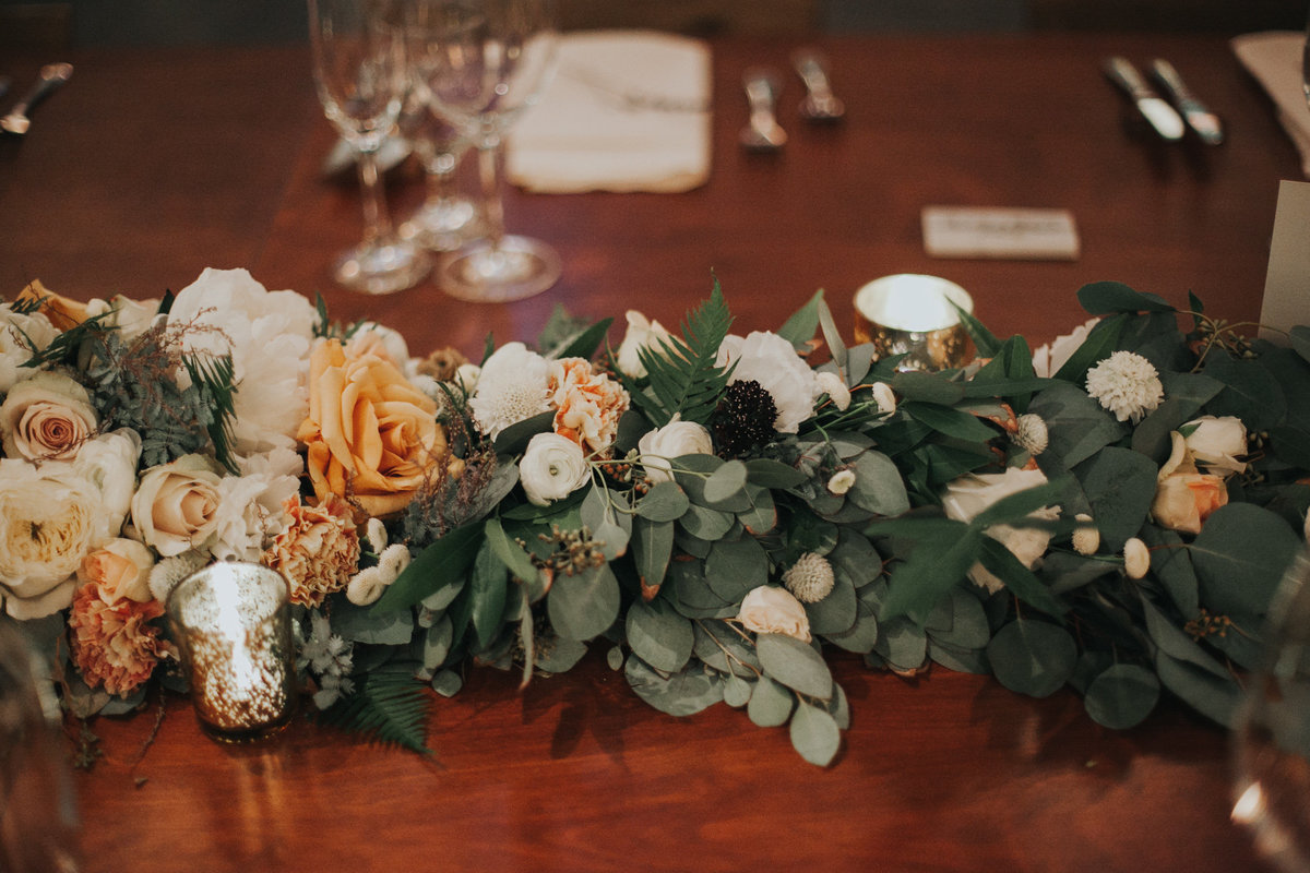Wedding reception table with long eucalyptus garland at The Fig House