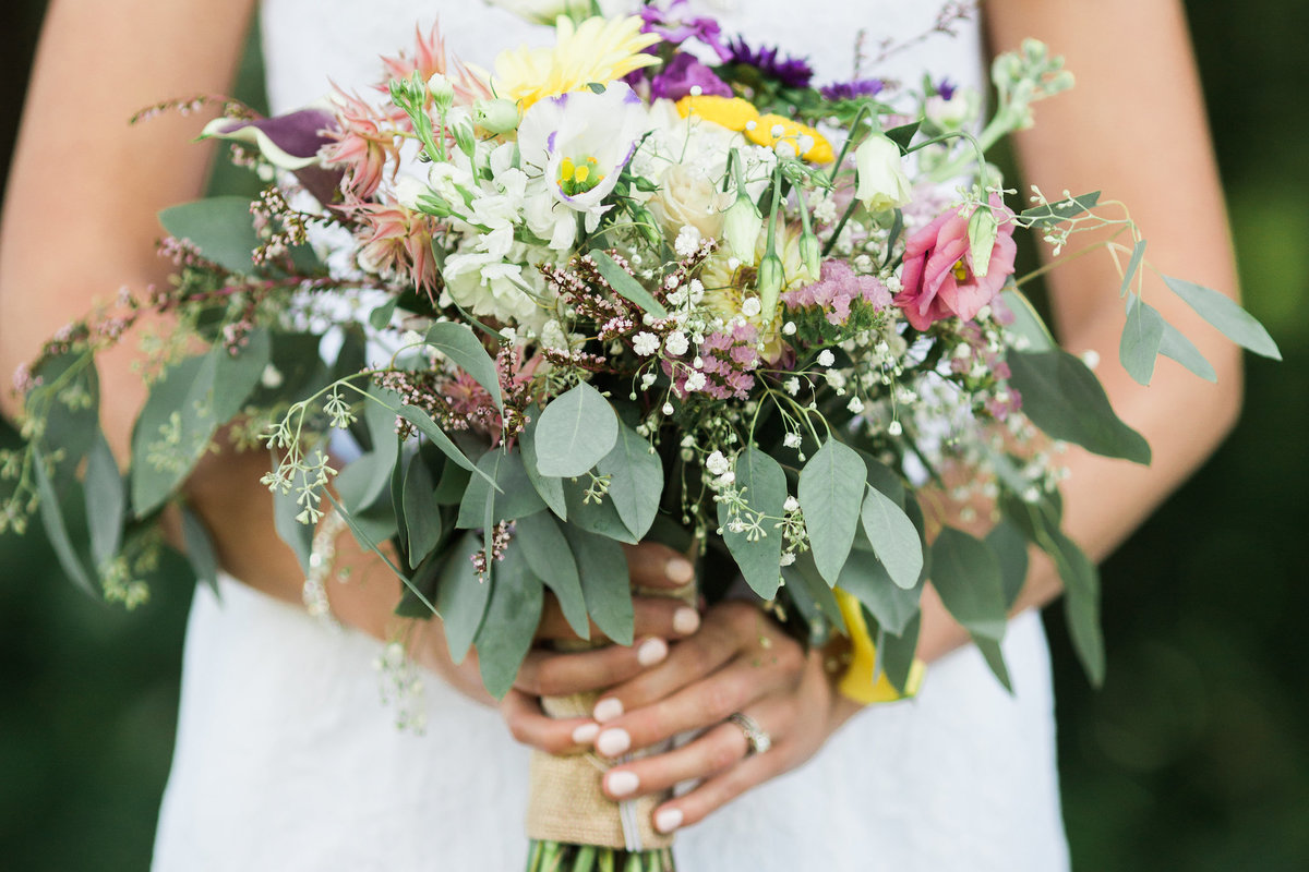 Bride holding bouquet by Grand Rapids MI Wedding Photographer