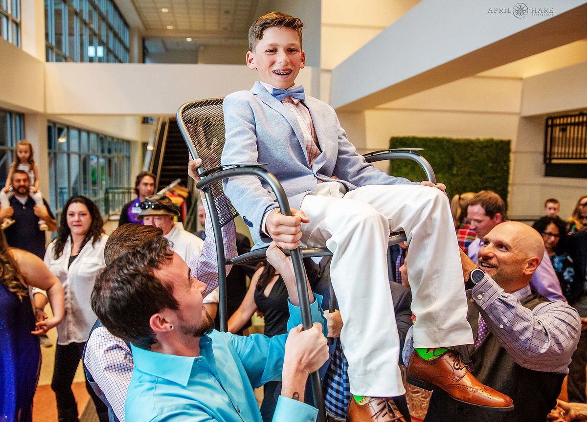 Chair Dance at Jewish Bar Mitzvah party at Coors Field in Denver Colorado