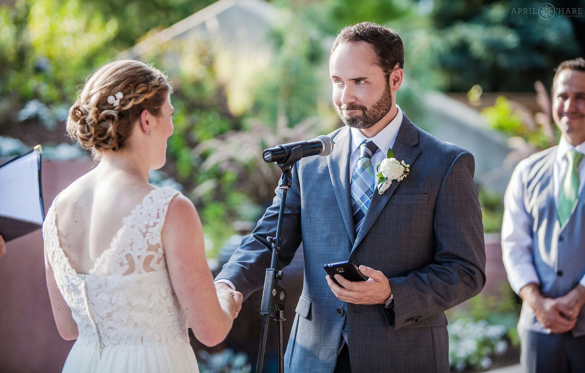 Wedding vows on a bright sunny wedding day at Denver Botanic Gardens All America Selections garden