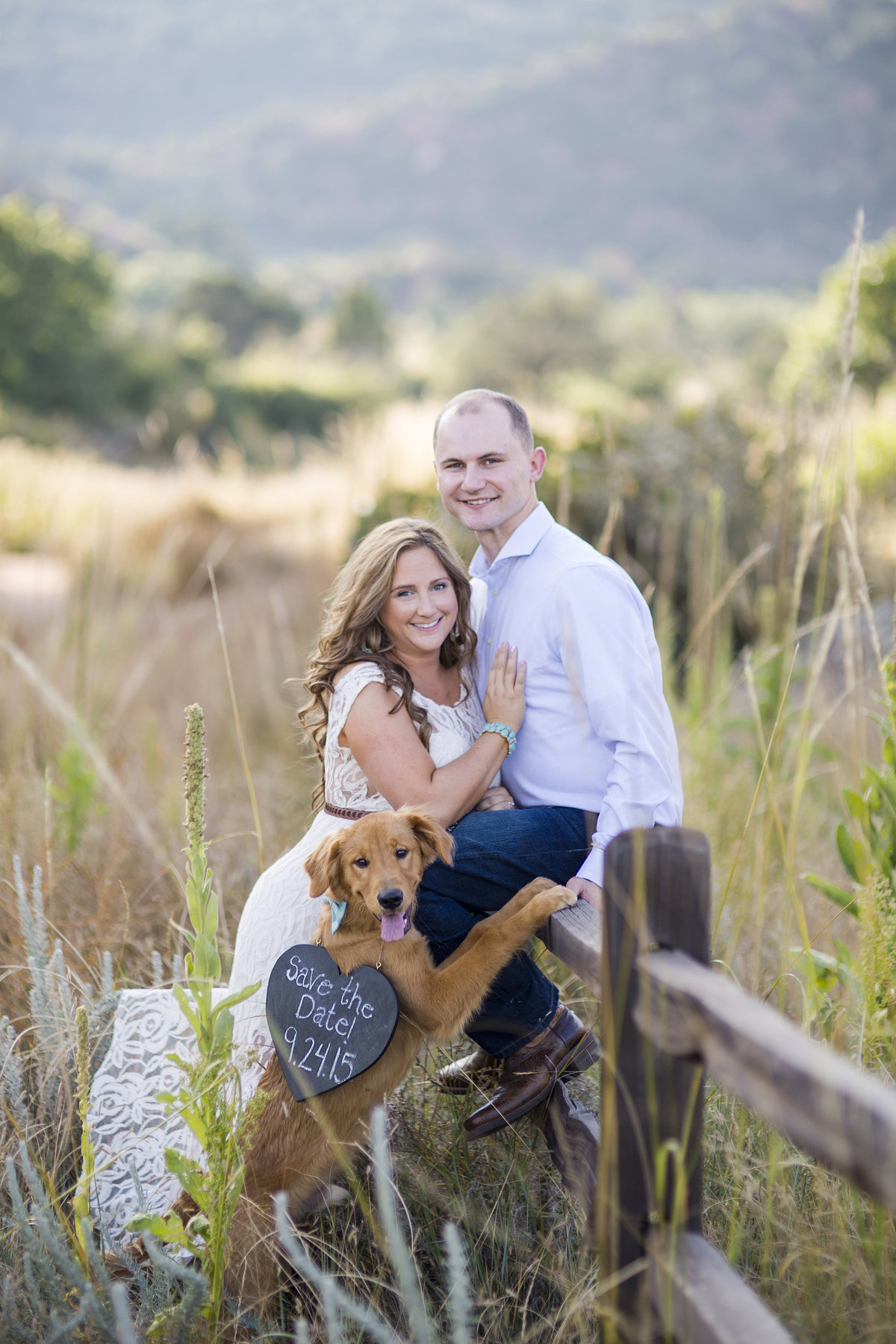 engaged couple with save the date and dog