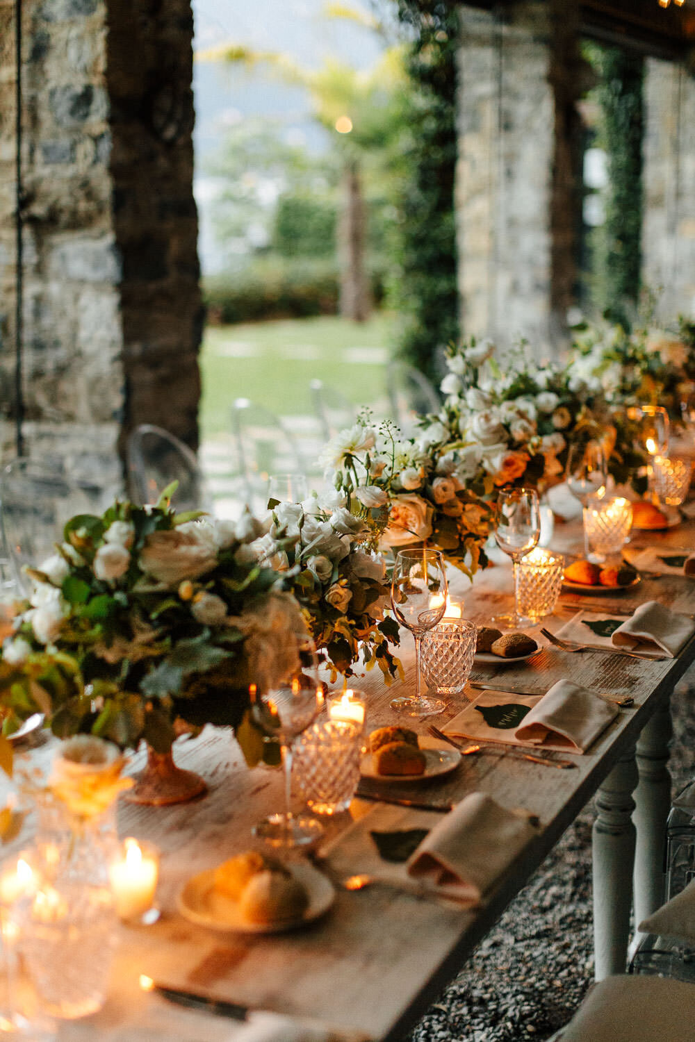 Lake Como Wedding Reception white florals long table with candles under roof