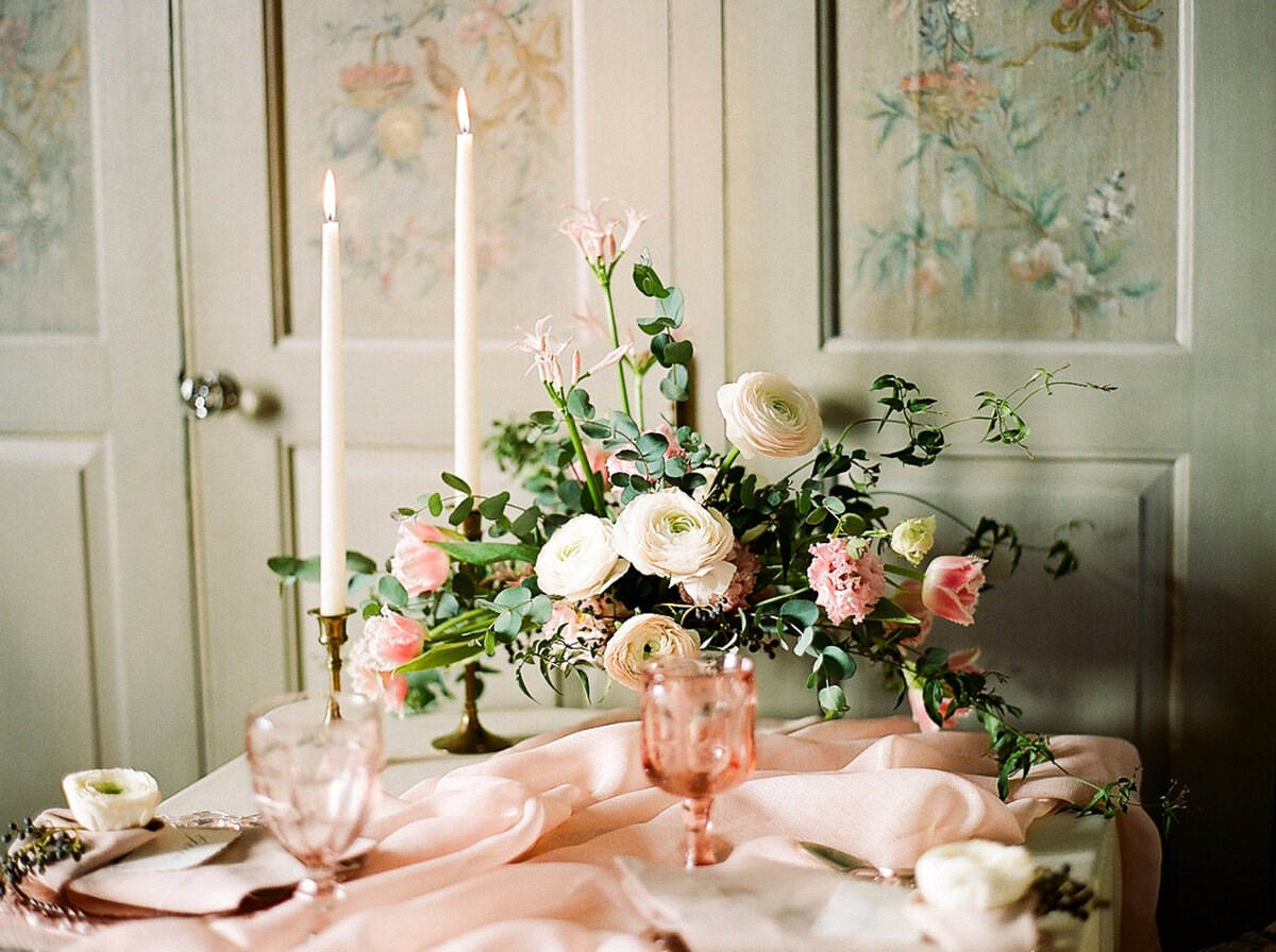 Pink and white floral centerpiece at destination wedding
