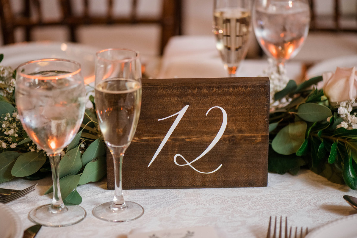 wedding photo of table number and setting from wedding at the Mansion at Timber Point