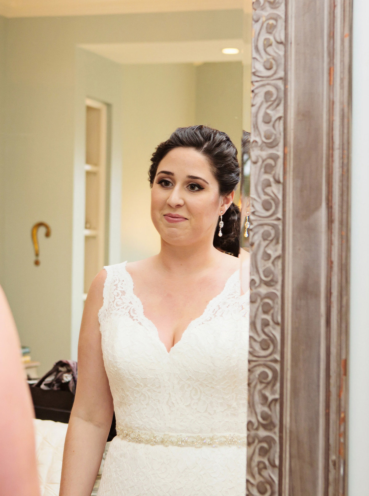new orleans bride looking in mirror getting ready