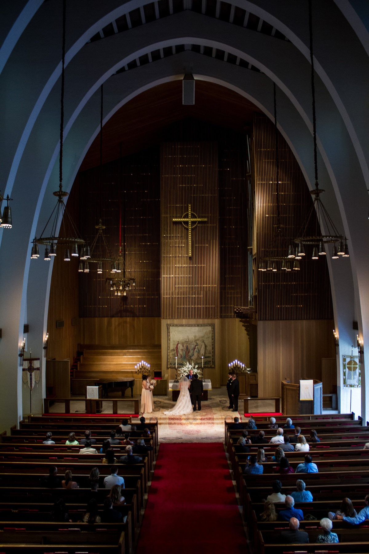 bride and groom at altar wedding ceremony at Margarite B. Parker Chapel at Trinity University