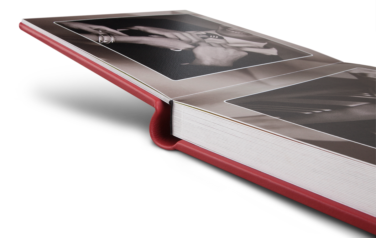 Lay flat wedding album with red leather cover.