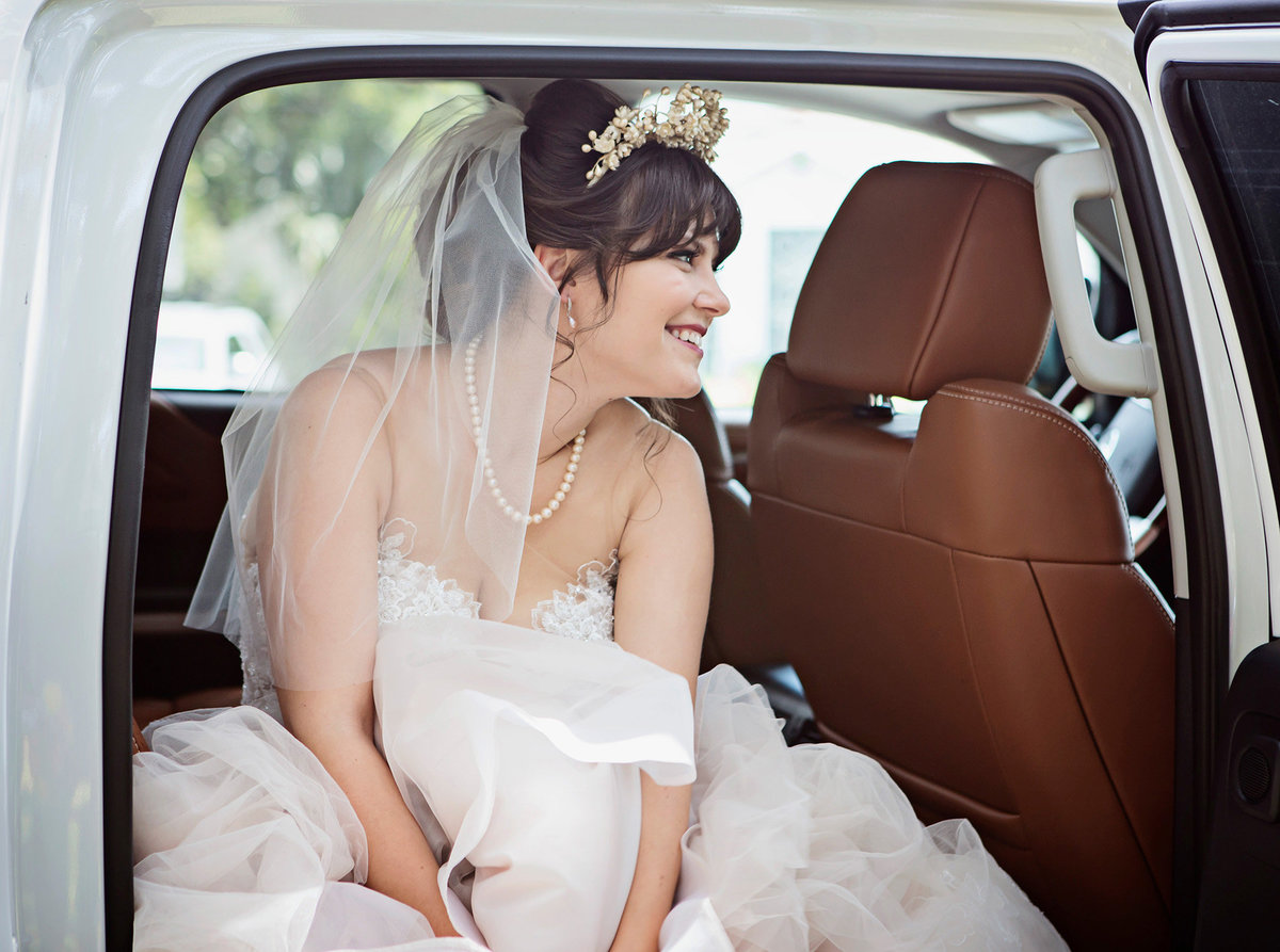 City Park bride waiting in limo before wedding ceremony