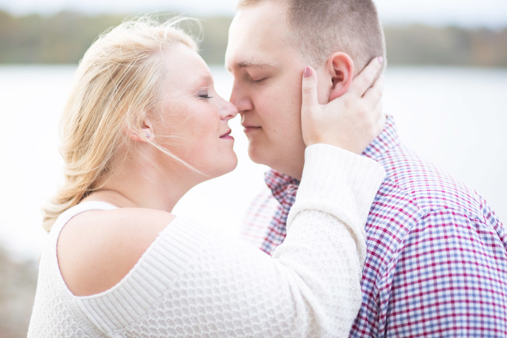 Engaged couple passionately kissing