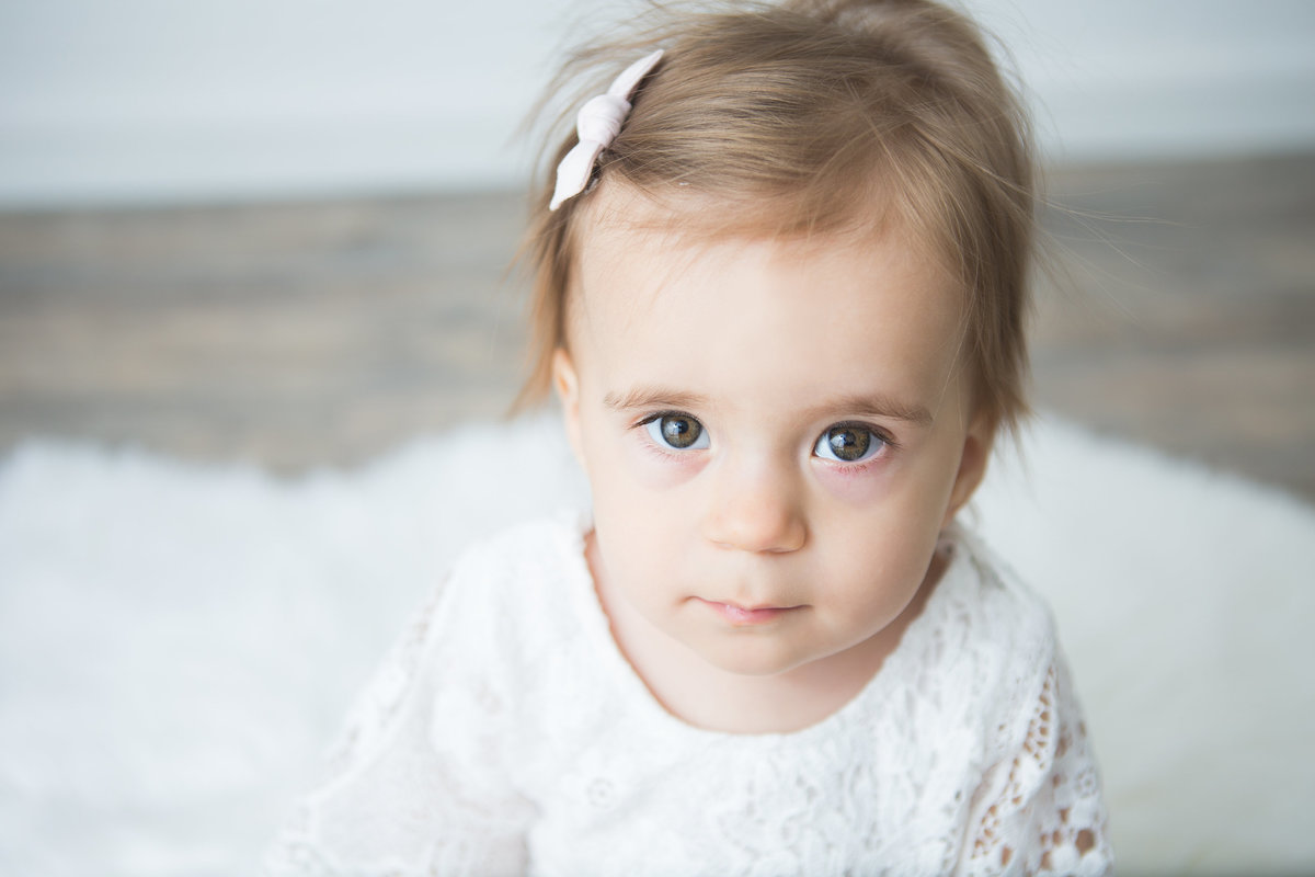 close up of baby girl looking straight into camera {Etobicoke Baby Photographer}
