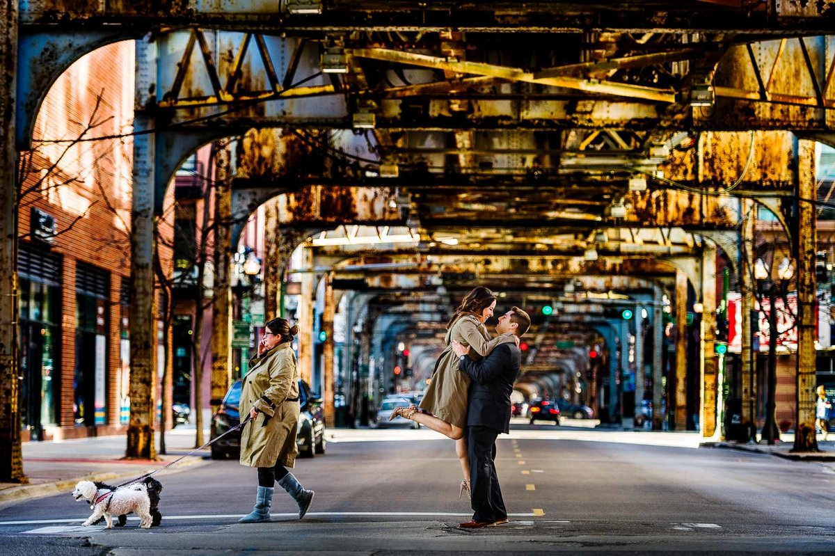 engagement photo in chicago under subway  by stephane lemaire photography