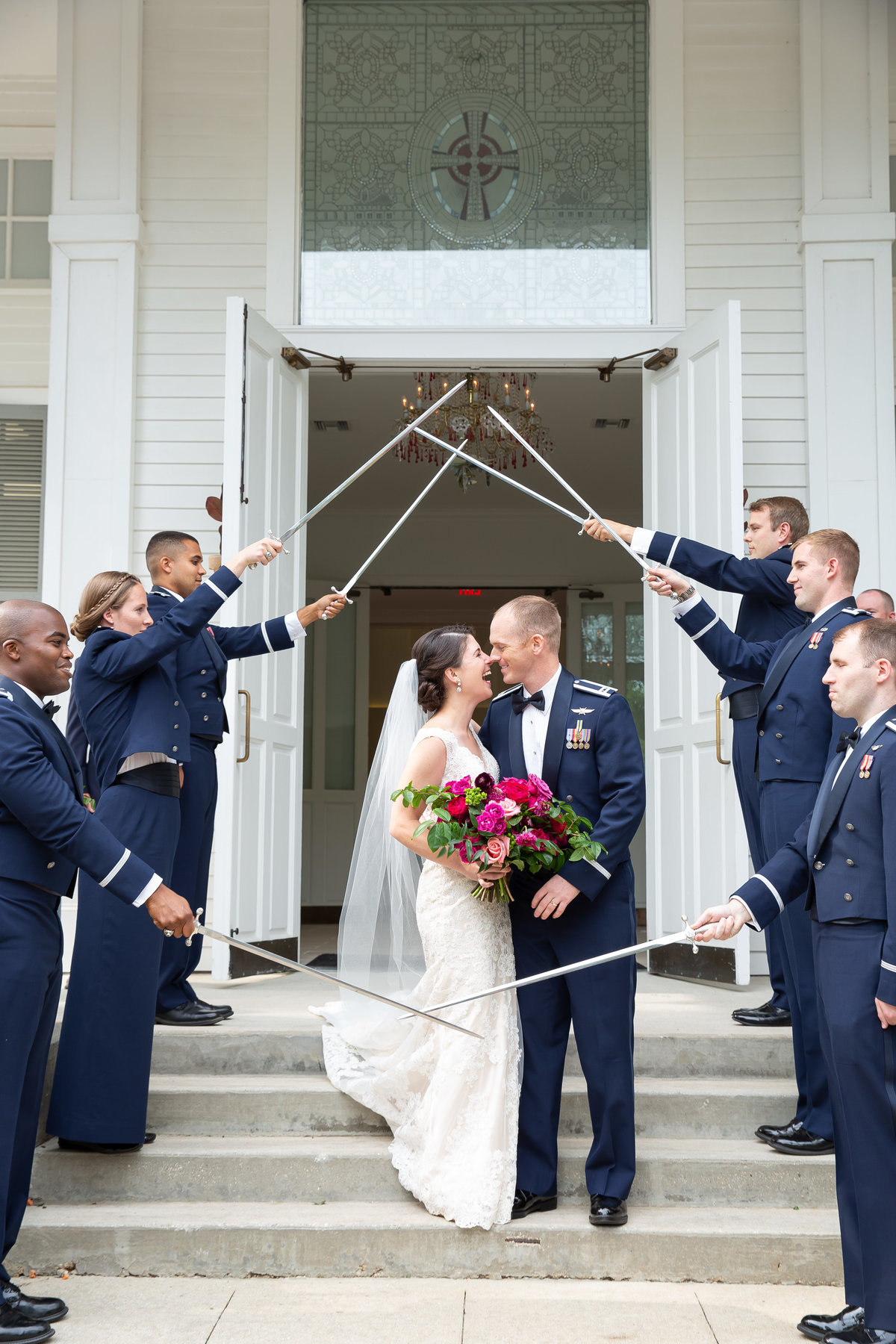 Military arch of swords wedding send off in Ocean Springs at First Presbyterian Church