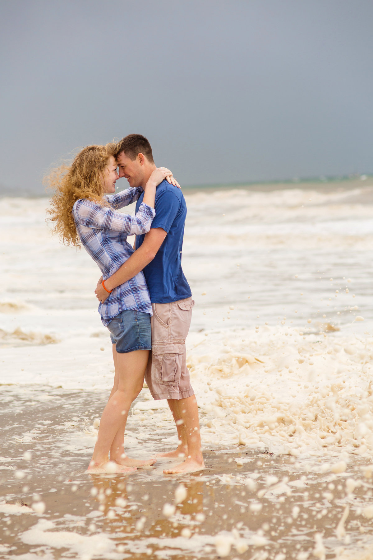 couple on beach for engagement photos